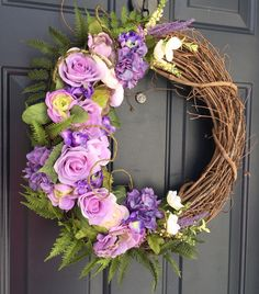 A personal favorite from my Etsy shop https://www.etsy.com/ca/listing/517175073/purple-rose-wreathspring-wreath-front