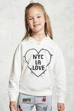"""Forever 21 Girls - A soft French terry knit hoodie featuring an """"NYC LA Love"""" graphic inside of a heart, a lace-up V-neckline, long sleeves, and a ribbed knit trim."""