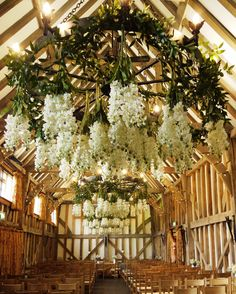 hanging flowers from the chandeliers @GateStreetBarn