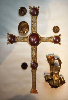 From the Saxon Staffordshire Hoard. -- (Gold Cross reconstruction.) Learn about the artistry of Anglo- Saxon craftsmen, and see ancient weapons of war that were works of art through Staffordshire and Sutton Hoo treasures.