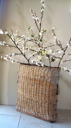 Create a pocket of joy in a corner you look at regularly. Lovely vintage French Champagne Gathering Basket (With Cheery Blossoms)