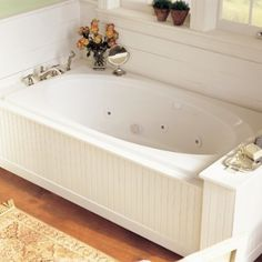 Drop-in tub with paneled framing                                                                                                                                                      More