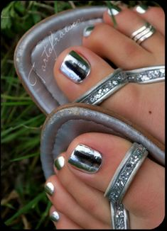 Silver toenails with a metallic shine, for a glossy look.  #silver # #fashion #style #pedicure #trend