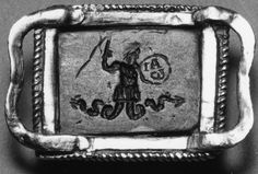 """Anonymous (Roman) """"Amulet of Mithras Slaying the Bull"""" (obverse) and the """"God Abraxas"""" (reverse) 3th-4th century. hematite, gold mount."""