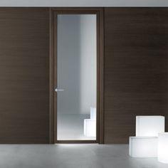 Rimadesio Quadrante. Openslaande deur en schuifdeur in aluminium en dubbel gelaagd glas. Quadrante betekent exclusieve oplossingen.  De gepatenteerde onzichtbare scharnieren, uitgerust met een exclusief  veersysteem, maakt het mogelijk om de opening van richting te veranderen zonder enige verandering aan de deur. Garantie voor een korte montagetijd !