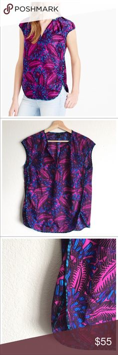 """New j. Crew silk top Blue and purple floral print blouse by J. Crew. Features include: scoop neckline and keyhole detail with hook and eye clasp, cap sleeves, cocoon style, curved high-low hemline, and all over blue and purple floral print. Silk construction.    Total length: 24"""" to 27"""" Bust: 42"""" Waist: 36""""  Sleeves: 3"""" J. Crew Tops Blouses"""