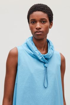 Model side image of Cos in turquoise