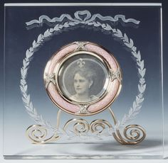 Fabergé frame, with a photograph of Grand Duchess Elizabeth Feodorovna, in rock crystal mounted with gold, rose diamonds and pink guilloché enamel. Mark of Michael Perchin. Grand Duchess Elizabeth Feodorovna, daughter of Princess Alice of Hesse and granddaughter of Queen Victoria, married Grand Duke Sergei, brother of Tsar Alexander III, in 1884. She was the sister of Tsarina Alexandra Feodorovna. Probably acquired by Queen Alexandra.