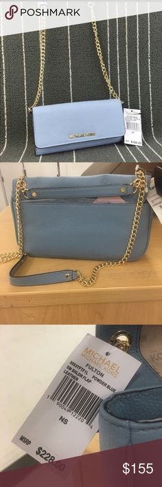 Authentic Michael Kors Fulton Cross Body Purse This purse is a powder blue leather.  Unlike the usually large purses by this designer, this is a great day to evening purse without all the weight of a larger handbag.  Purse has a leather and chain strap with a 9 - 15 inch drop.  Brand new with tags.  Chain on strap is gold. Michael Kors Bags Crossbody Bags