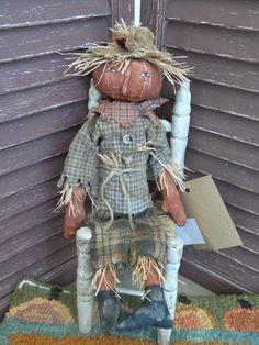 VERY Primitive, Scarecrow, Pumpkin, Fall, Halloween, Harvest, Autumn, TeamHAHA, Hafair, Recycled, Upcycled, Old Cloth, Doll by Mustard Seed Originals on Etsy.com. Meet 14 tall Field helper Mack. He has a pumpkin head and body. Mack wears a grey plaid shirt and heavy greyish green plaid trousers. He has an orange plaid collar with several old buttons hand stitched down the front of his shirt. Rope was used to tie around for a belt. He wears a faux straw hat with lots of hay sticking out…