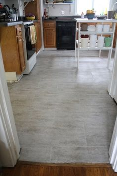 Gray Kitchen Floor Tile Offset Great With White Cabinets
