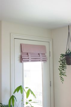New Dusty Rose French Door Curtain. Like a Roman Shade but no holes and no cords. Fast and easy installation with no hardware needed. Fold it. Flip it. Roll it.