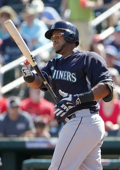 Seattle Mariners' Nelson Cruz reacts after swinging for a strike during the second inning of a spring training baseball game against the Cincinnati Reds, Sunday, March 8, 2015, in Goodyear, Ariz.