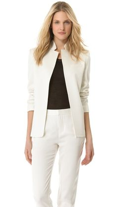 T by Alexander Wang Shiny Crepe Angle BlazerShimmering crepe lends a tuxedo-inspired feel to this angled-placket blazer from T by Alexander Wang. The seamed stand-up collar is notched at the front, and a faux-welt pocket and back vent complete the piece. The long sleeves end in buttoned cuffs. Lined.  Fabric: Lightly textured crepe. Shell: 70% acetate/30% rayon. Lining: 100% polyester. Dry clean. Imported, China.