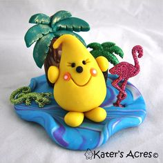 Tropical Parker© Limited Edition Polymer Clay Figurine by KatersAcres. Includes palm trees, lizard, & flamingo. --- ADOPTED