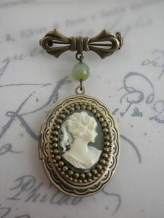 Hey, I found this really awesome Etsy listing at https://www.etsy.com/listing/178250356/jane-austen-green-cameo-locket-brooch