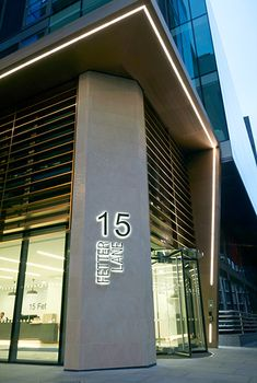 - PVD stainless steel brise soleil, canopy and column. - The backlit signage on the limestone column. By John Desmond Ltd Backlit Signage, Entrance Signage, Exterior Signage, Entrance Design, Led Exterior Lighting, Facade Lighting, Linear Lighting, Balcony Lighting, Building Front