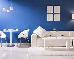 living room paint ideas blue color with white sofa