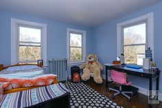 Even the teddy bear seems to be enjoying the three new windows we installed in this teen's blue bedroom   . . . . . .   Remodeling / Renovations / Home Improvement / Bedroom replacement windows from Renewal by Andersen Long Island