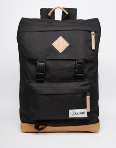 """Backpack by Eastpak Canvas textile Top grab handle Flap top with buckle fastening Front zip pocket Signature branding Adjustable shoulder straps Wipe with a damp cloth 100% Polyester H: 43cm/17"""" W: 27cm/11"""" D: 13cm/5"""""""