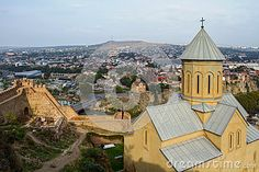 St. Nicholas Church in the fortress Narikala, panoramic city views of St. George's Bridge of Peace and Sameba, Tbilisi.
