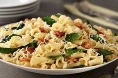 No tomato sauce needed for this easy pasta dish—just bacon, Italian dressing, baby spinach leaves and shredded cheese.