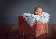 This stunning newborn portrait was created in a garage using natural light - check out the accompanying pullback shot for the setup - amazing!