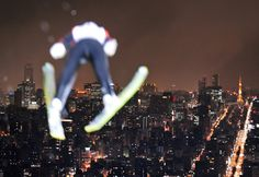 A skier jumps before the Sapporo skyline during an official training session of the World Cup ski jumping competition at Okurayama Hill on January 14, 2011. (Kazuhiro Nogi/AFP/Getty Images).