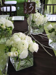 PURELY WHITE - Ranunculus, roses, freesia, hydrangia - Maybe with a soft pink satin ribbon wrapped around the vase