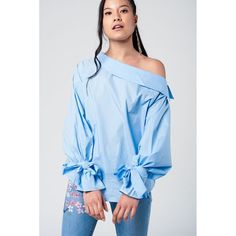 Blue cold shoulder shirt with laced cuffs https://porschstores.com/products/blue-cold-shoulder-shirt-with-laced-cuffs