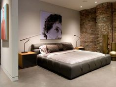 bachelor bedroom ideas brick walls leather bed wall picture modern lighting