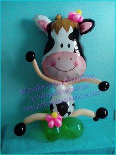 Fun, creative cow themed balloon decor