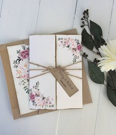 This rustic elegant kraft, beautiful floral pocket invitation is the perfect for any rustic boho chic wedding. The invitation is printed on kraft card stock paper and then layered in the off white floral pocket with hand distressed edges. Wrapped twine and tag. SAMPLES- Purchase this
