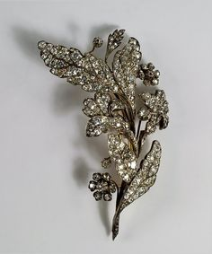 A large and impressive diamond floral spray brooch, 19th century, in the form of irises, old cut and cushion cut diamonds in an unmarked white and yellow metal setting, with detachable brooch fitting, approx 9.5cm long, in fitted case.
