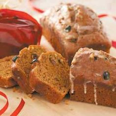 Pistachio Pumpkin  Bread Recipe -These cute little loaves blend pumpkin, pistachio, rum and raisins with festive results. Wrap the bread in colored cellophane, tie with festive ribbon and give as a gift. —Kathy Kittell, Lenexa, Kansas.