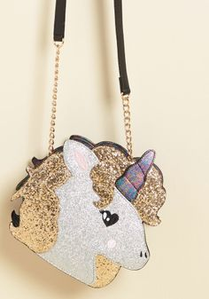 It is our delight to introduce you to this sparkling unicorn purse! All gussied up with gold and silver glitter, and finished with a midnight marbled back to match its horn, this accessory from Betsey Johnson will make Real Unicorn, Unicorn Gifts, Magical Unicorn, Cute Unicorn, Unicorn Fashion, Unicorns And Mermaids, Zooey Deschanel, Cute Bags, Unicorn Birthday