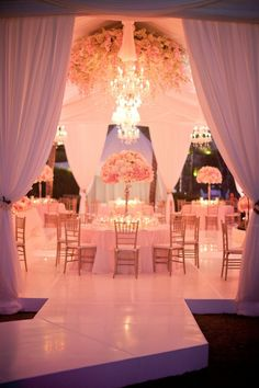 Gorgeous!   Wedding Reception. #Rpund Table Settings. #Wedding Centerpieces #Table Arrangements. #Wedding Flowers. #Wedding Tent. #www.celebritystyleweddings.com #CelebStyleWed. #Candy Pink Color. #Elegant Wedding.
