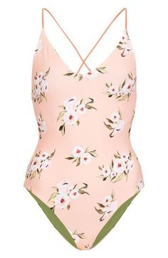 Free shipping and returns on Topshop Posie Reversible One-Piece Swimsuit at Nordstrom.com. Mix up your beach look this holiday with a reversible one-piece swimsuit that's solid on one side with romantic blossoms on the other, all suspended by dainty crisscrossed straps.
