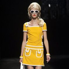 Moschino Spring 2013- Inspired form the 60's mod style tribe. Short mini skirt, with very geometric shapes, and shift like dress line