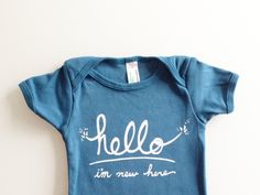 Funny text baby bodysuit  Hello I'm New Here 03 mo  by eggagogo, $18.00