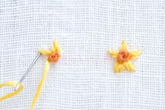 Learn how to embroidery the tiniest of floral designs with a few simple stitches. They're perfect for making embroidered jewelry!: How to Make a Tiny Daffodil