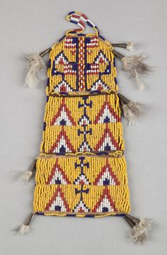 A SIOUX PICTORIAL BEADED HIDE POUCH.