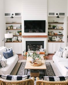 white and wood modern farmhouse style living room with shiplap fireplace - See Instagram photos and videos from Kelsey Herr | Styled By Herr (@kelseyherr_)