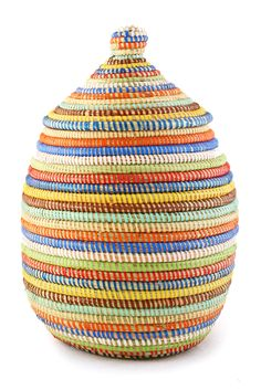 This rainbow striped basket add so much color and joy to any room of your home. Only 3 left, so grab yours today! 10% off with the code FALL15. #rainbow
