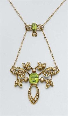 Gold, Peridot and Split Pearl Lavaliere   C. 1900, ap. 4.8 dwt. Length 15 inches