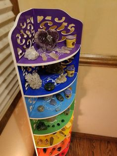 This shelf stands at 46 inches tall and has 7 shelves that are inches between and inches deep. Each hand painted the color and symbol of each chakra. A great way to display your crystals and align your chakras Chakra Crystals, Crystals And Gemstones, Stones And Crystals, Meditation Space, Chakra Meditation, Chakras, Deco Zen, Reiki Room, Crystal Shelves
