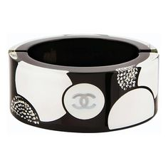 Chanel Black & White Circle Print Lucite Bangle ❤ liked on Polyvore