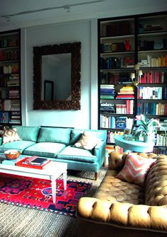 I'm not in love with the overall styling, but I want BOTH of those sofas (yellow leather tufted Chesterfield, turquoise velvet with dark blue piping).