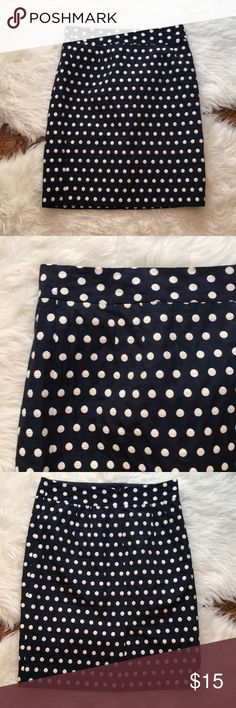 """Banana Republic Navy/ White Polka Dot Pencil Skirt Banana Republic pencil skirt in excellent condition.  Classic navy sprinkled with crisp white polka dots.  Can be dressed up or down depending on the occasion.  Concealed back zipper.  Back vent.  Fully lined. Length is about 21,"""" waist is approximately 29.""""  Shell 65% cotton, 35% polyester; lining 100% acetate.  Size 4P. Banana Republic Skirts Pencil"""
