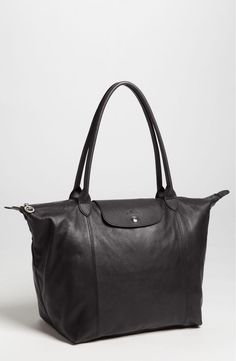 Gorgeous black leather upgrades this spacious dual-handle Longchamp tote that is perfect for a full day or weekend getaway. / @nordstrom #nsale